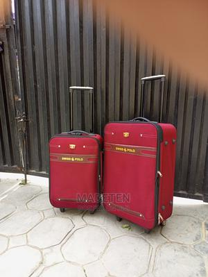 Double Zippered Swiss Polo Trolley Luggage Red Bag   Bags for sale in Lagos State, Ikeja