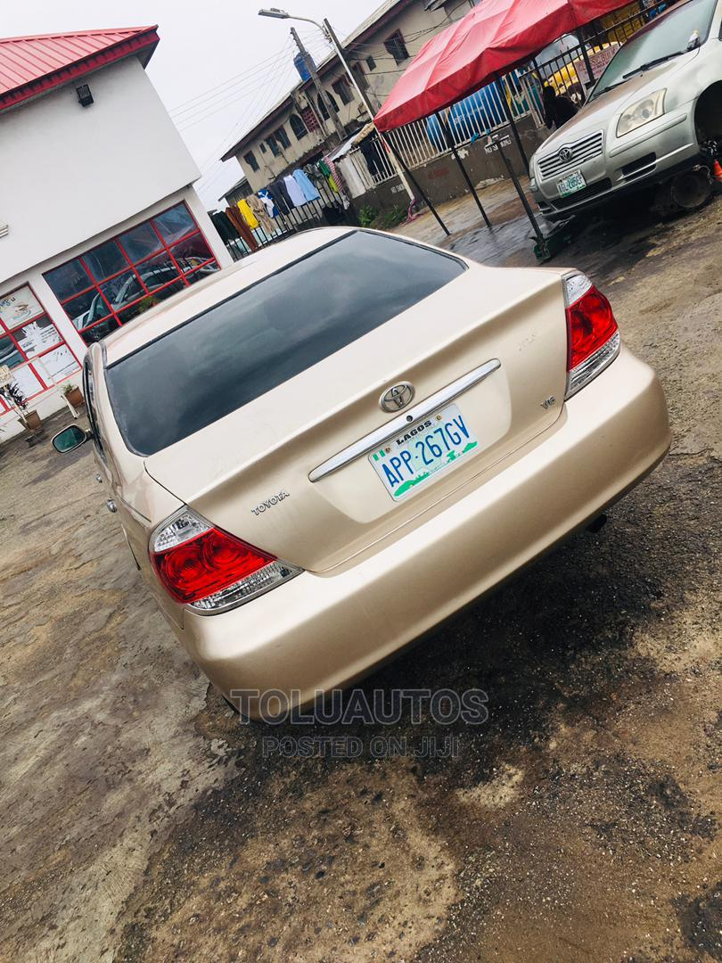 Toyota Camry 2005 Gold | Cars for sale in Ogba, Lagos State, Nigeria