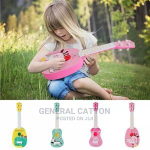 Mini Four Strings Ukulele Guitar Musical Instrument Children | Toys for sale in Lagos State, Ikoyi