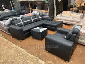 Brown L- Shaped Leather Sofa With a Single Center Table   Furniture for sale in Lagos State, Ikeja