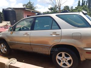 Lexus RX 2000 Gold | Cars for sale in Lagos State, Ikeja