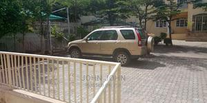 Honda CR-V 2006 LX Automatic Gold | Cars for sale in Abuja (FCT) State, Apo District