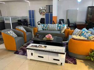 7 Seaters Sofa , Center Table .Orange and Black Sofa   Furniture for sale in Lagos State, Ojo