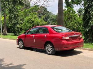 Toyota Corolla 2013 Red | Cars for sale in Abuja (FCT) State, Central Business District