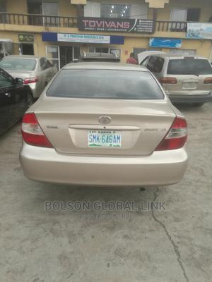 Toyota Camry 2004 Gold   Cars for sale in Lagos State, Ojodu