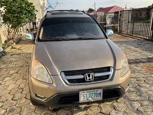 Honda CR-V 2004 EX 4WD Automatic Gold | Cars for sale in Abuja (FCT) State, Karshi