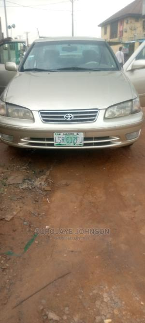 Toyota Camry 1999 Automatic Gold | Cars for sale in Lagos State, Agege