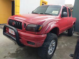 Toyota Tacoma 2004 Double Cab V6 4WD Red | Cars for sale in Lagos State, Ikeja