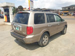 Honda Pilot 2005 EX-L 4x4 (3.5L 6cyl 5A) Gold | Cars for sale in Lagos State, Isolo