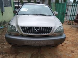 Lexus RX 2000 300 2WD Gold   Cars for sale in Lagos State, Alimosho